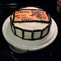 "Get Out Of Jail Free! Vanilla cake covered with buttercream. The orange card is made out of MMF and written on with black piping gel. The jail cell ""bars&..."