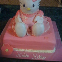Hello Kitty made from stand-up bear pan set, chocolate cake with vanilla filling and fondant covered. Vanilla and fondant flowers, beads are piped...