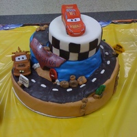 Cars Themed Baby Shower Cake Fondant covered, carved Cars themed baby shower cake.
