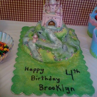 Enchanted Castle Cake Enchanted Castle cake. Fondant covered chocolate cake. Carved and stacked.