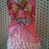 "Barbie Doll Dress Cake I used 7"", 6"" and 5"" tins. It was 7 layers in the end as barbie is very leggy! For the ruffles i used my pasta machine to..."