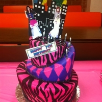 Topsy Turvy Shake It Up Birthday Cake 3 tier topsy turvy cake for a 7th birthday party. The Shake It Up stuff on the cake is from a cake topper my friend ordered that we...