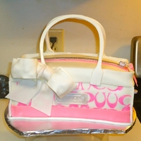 Coach Purse Strawberry cake with vanilla buttercream, covered in fondant with fondant and gumpaste accents.