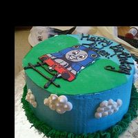 Thomas The Train Cake Thomas the Train birthday cake for a 2 year old little boy. All buttercream except for the hills which are fondant.