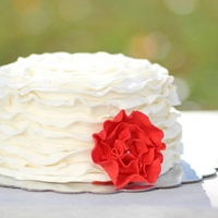 Ruffle Cake With Red Ruffle Flower Strawberry filled white cake with MMF with tylose powder added to stiffen the ruffles. Used as a Graduation cake for a friend getting her...