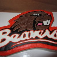 "Oregon State Beavers Logo cake make from a 9X13 sheet cake pan. Everything is buttercream except the black background and the white candy melt word ""..."
