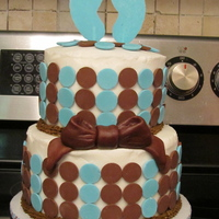 It's A Boy Mod blue & brown baby shower cake. Buttercream and chocolate melts.