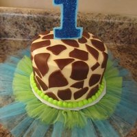 G Is For...giraffe Giraffe & Tutu cake inspire by the 1st Birthday Girl's outfit. Buttercream with fondant accents. The tutu is attached to the...