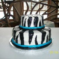 Zebra Cake I made this cake for a 13th birthday girl. I don't use fondant, just a creamy frosting recipe, so it is a job to smooth out all the...