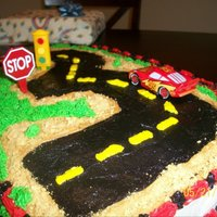 "Dinsey ""cars"" Cake This cake was made for my nephews 3rd birthday party. He spent a while driving his little cars on the ""road""!"