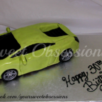 Lamborghini Cake First car cake... hand carved. Covered in MMF. Tires are not edible. Not to shabby for my first one!