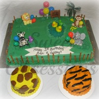 Zoo 1St Birthday Cake With Smash Cakes   Animals are made out of fondant. I put pretzels around the outside to give more of a zoo feel and not a jungle theme. TFL