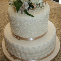 Ivory Wedding Chocolate cake with cream cheese filling and fondant.