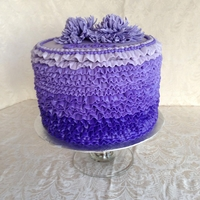 Purple Ruffles Chocolate mocha cake with a cream cheese frosting and gumpaste flower.