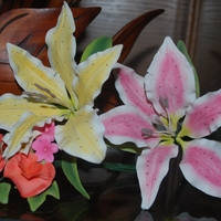 Lilies And Sweet Peas. This was my first attempt at the gumpaste lilies and sweet peas.