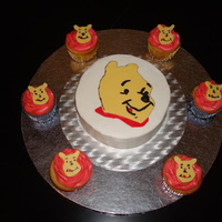 Pooh Smash Cake And Cupcake Here is the smash cake for the pooh cake and the cupcakes to go with the cake for his daycare.