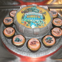 "'skylanders Battle Arena!' 'Skylanders Battle Arena' with matching cupcakes. 8"" vanilla cake and cupcakes. Edible image toppers. A fun cake to make..."