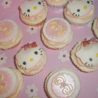 Hello Kitty Cupcakes Vanilla cupcakes with white and pink vanilla buttercream, finished with a fondant 'Hello Kitty' or number topper x