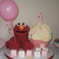 3D Elmo With A Giant Rainbow Cupcake For My Beautiful Granddaughters 1St Birthday 3D Elmo with a Giant Rainbow Cupcake for my beautiful granddaughters 1st birthday.