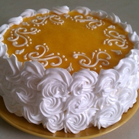 1342829693.jpg This is coconut cake with pineapple filling , on top mango pure mixed with gelatin , covered with Italian merengue , it's was very...