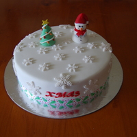 2012 Christmas Rich fruit cake covered in marzipan and fondant icings. Decorations handmade & edible.