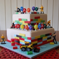 Seth Choc mud and choc mint mud cake. Covered in fondant. Lego blocks made from fondant/gumpaste mix. Lego Toy loader sitting at base....