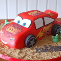 Lightening Mcqueen Cake White Choc Mudcake Covered In Fondant Rusteze 95 Head Lights Etc Were From Edible Images I Had Printed Up  Lightening McQueen cake. White choc mudcake covered in fondant. Rusteze, 95, head lights etc were from edible images I had printed up :-)...