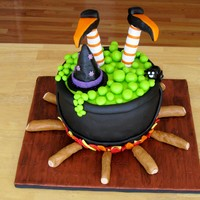 Witches Cauldron Witches cauldron cake. Cauldron is white cake with chocolate buttercream. Legs and Hat are made from cereal treats. I saw the cake that...