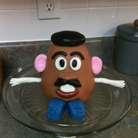 Mr. Potato Head Cake I was trying out my new ball pan and decided to use it to make Mr. Potato Head.