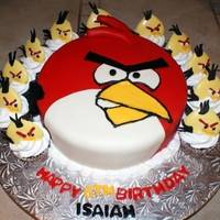 Angry Bird Vanilla Cake with MM fondant. The cupcakes where made with buttercream icing and the birds on top were made from heart molds inverted and...