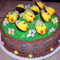 Easter Cake  This is a triple layer vanilla cake. Each layer is coloured differently, yellow, pink and green. I made cake pops out of the tops and...