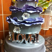 Romantic Wedding Purple and silver wedding cake with silver love lettering