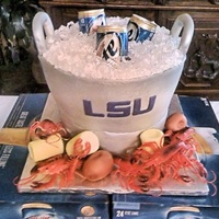 Lsu Beer Bucket Grooms Cake Iced With Buttercream Corn And Potatoes Made Of Fondant LSU beer bucket grooms cake. Iced with buttercream corn and potatoes made of fondant.