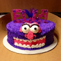 "12 Round Cute Cake Monster Name Is Made From Glittered Foam Sheets And Added Stones To Bling It And A Feather Flower In The Background Al 12"" round cute cake monster. Name is made from glittered foam sheets and added stones to bling it and a feather flower in the..."