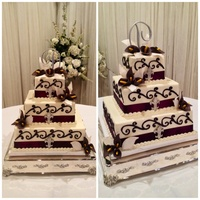 Eggplant Purple Gum Paste Calla Lillies Square Wedding Cake Decorated With Large Scrolls Ribbon And Fleur De Lis Iced With Buttercream Ic Eggplant purple gum paste Calla Lillie's square wedding cake decorated with large scrolls, ribbon and fleur de lis. Iced with...