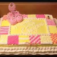Quilted Theme Baby Shower Quilted designed cake for a baby girl baby shower. All decorations are buttercream icing except the bib and the baby booties. Botties are...