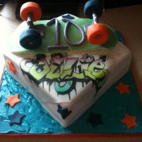 Skateboard Graffiti Cake 10 year old boys cake. very pleased with my modelling but my cakes are still wobbly! Argh!