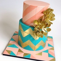 Luxury Geometric   Peach and turquoise geometric design featuring gold succulent accents