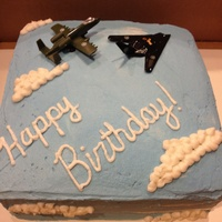 Jet Fighter Cake Experimented with buttercream to make clouds.
