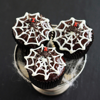 Black Widow Spider Cupcakes Chocolate rum cupcakes topped with chocolate ganache and piped chocolate decorations. Melted white chocolate was used to make spiderwebs,...