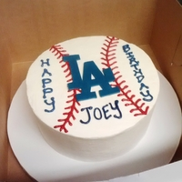 La Dodgers Birthday Cake Banana cake with 1:1 milk and dark chocolate ganache filling and coconut SMBC frosting. Covered with a gumpaste Dodgers logo and colored...
