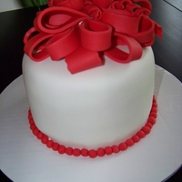 My First Bow Chocolate cake with custard and fresh strawberries. Covered in buttercreme and MMF. Thanks for looking!