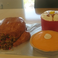 Thanksgiving Feast! Turkey, mashed potatoes and pumpkin pie cakes. All fondant-covered. (Potatoes are meringue buttercream, gravy is caramel sauce and stuffing...