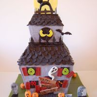 Spooky Haunted House For Halloween Themed Birthday! Haunted house with spooky eyes in windows. All details are hand made and are completely edible. Total of 3 tiers.