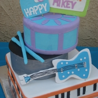 Fresh Beat Band Cake Cake of Fresh Beat Band's instruments--keyboard, turntable with record and drum tiers, and Kiki's guitar. I wanted to make...