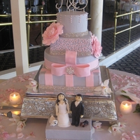 Pink And Gray Bling-Y Cake! This is my 2nd wedding cake. Bride wanted her wedding colors, with sparkle, peonies and figures of the bride and groom with their dogs. My...