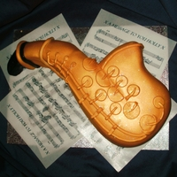 Saxaphone Cake SAXAPHONE CAKE ~ A 10 INCH VANILLA CAKE FILLED WITH BUTTERCREAM AND JAM HANDCARVED INTO A SAXAPHONE SHAPE. THIS CAKE IS COVERED WITH...