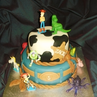 Toy Story Cake TOY STORY CAKE ~ A 9 INCH AND 6 INCH TWO TIER VANILLA CAKE FILLED WITH BUTTERCREAM AND JAM AND DECORATED WITH FONDANT AND ADORNED WITH...
