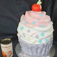 "Giant Birthday Cupcake - Handcarved GIANT BIRTHDAY CUPCAKE - TWO 9"" AND ONE 8"" VANILLA CAKE FILLED WITH BUTTERCREAM AND JAM AND HANDCARVED INTO A GIANT CUPCAKE...."