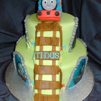 "Thomas The Tank Engine Cake  THOMAS THE TANK ENGINE CAKE - 9"" AND 6"" VANILLA SPONGES FILLED WITH JAM AND BUTTERCREAM AND DECORATED WITH EDIBLE THOMAS FRIENDS..."